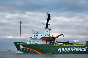 17 September 2013: The Arctic Sunrise with Prirazlomnaya oil platform in the distance